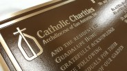 Catholic Charities Bronze Precision tooled plaque