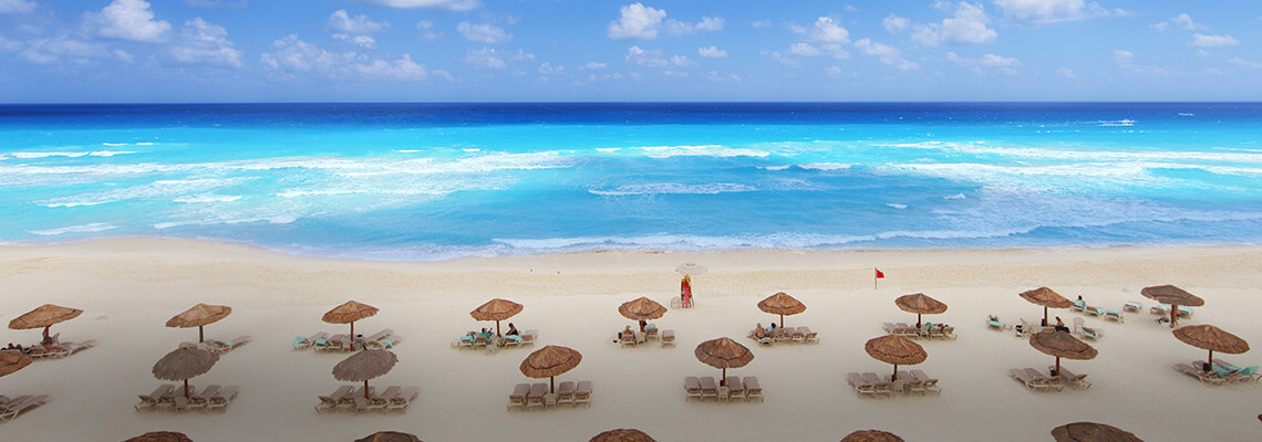 air travel beach chairs video game chair with cup holder international flights southwest airlines and umbrellas on a in cancun mexico