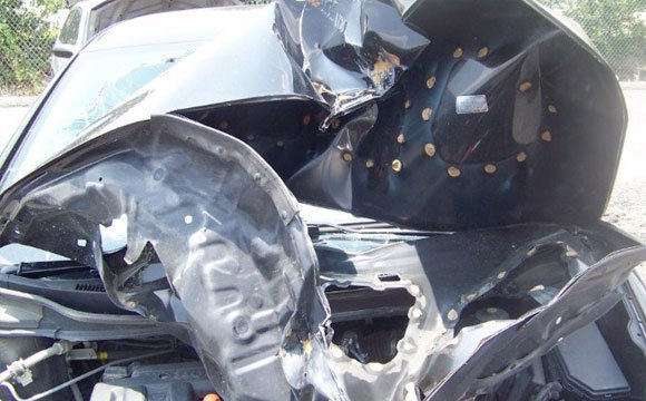 """The Louisiana Attorney General says this car had what it calls an """"aftermarket"""" hood part, and when the car was in a wreck, the hood crumpled in a way it should not have."""