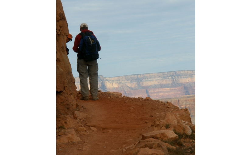 person on narrow canyon path