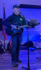 Mike Curran playing on the Southwoods Stage