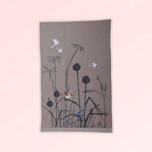 Tea towel with an embroidered pair of blue wrens perched in grasses. The fabric is a natural Australian organic cotton.