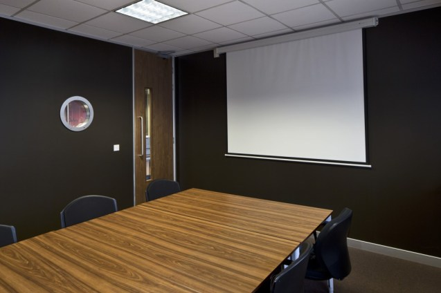 Image of Ogilvy 4D meeting and training room with retractable AV presentation screen
