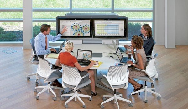 Picture of staff working in an tele-conferencing office