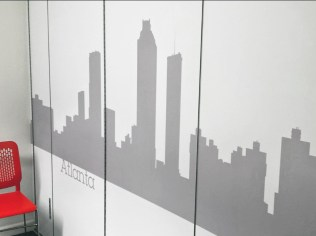 image of Lane 4 retractable office divider wall with vinyl decals
