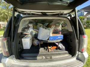 Loading Up car with donations after decluttering
