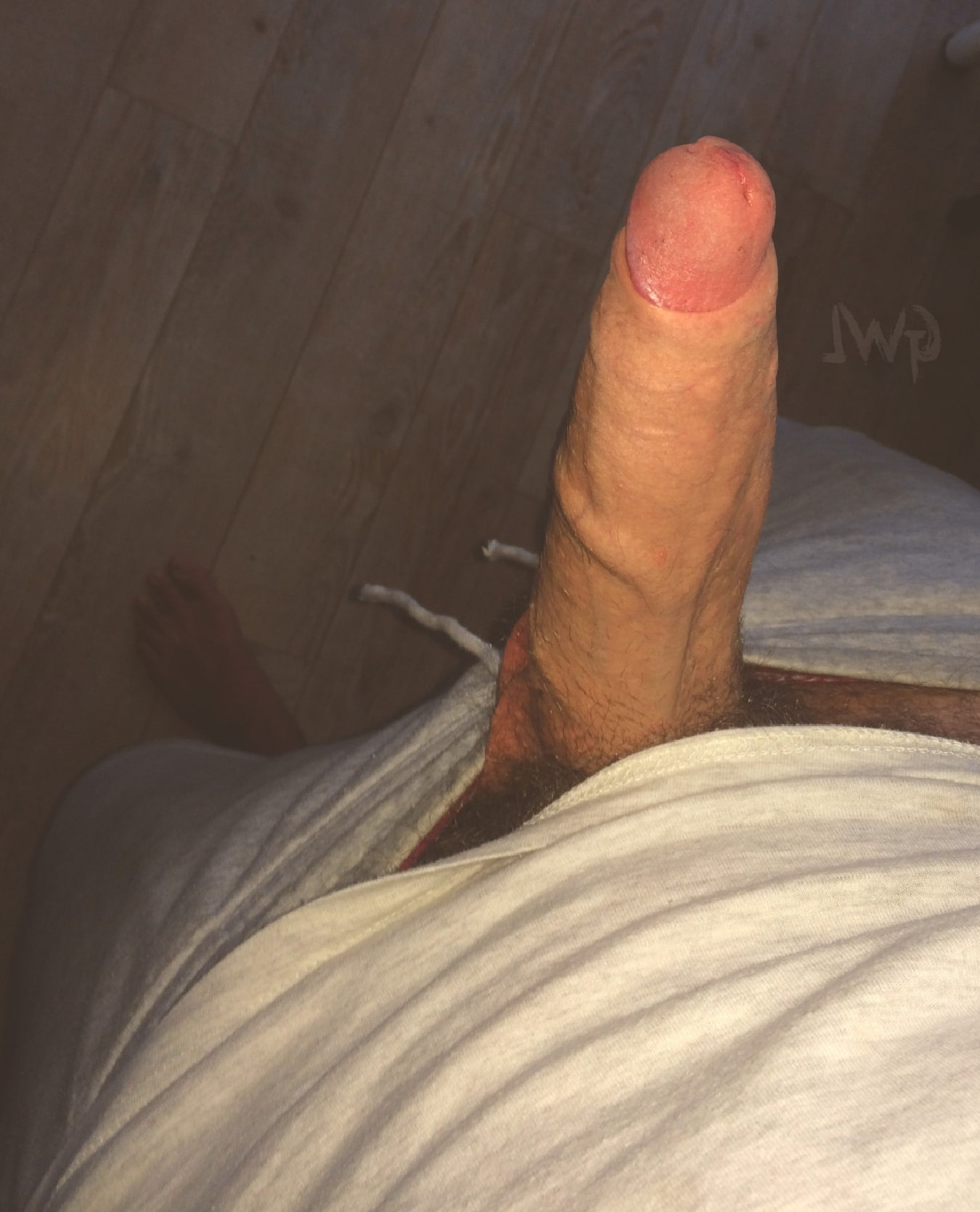 Horny Guy With His Shorts Pulled Down Take A Closeup Picture Of His Big Sexy Hard Uncut Cock