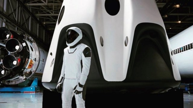 SpaceX's spacesuit next to a Crew Dragon capsule. Photo Credit: Elon Musk / SpaceX