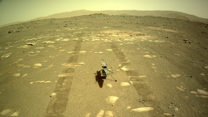 The Ingenuity helicopter has been deployed on the surface of Mars after hitching a ride to the red planet on the belly of the Perseverance rover. Credit: NASA