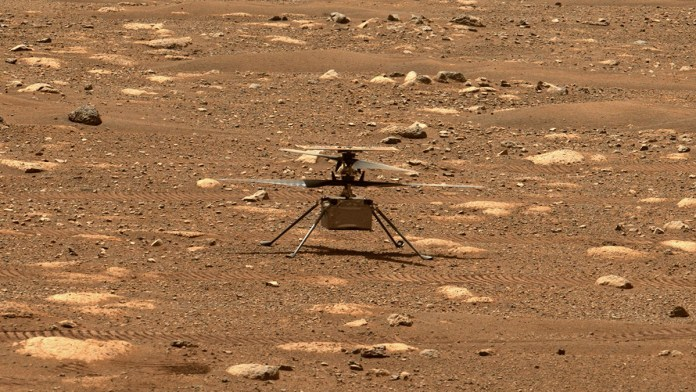 NASA's Ingenuity Mars helicopter is seen with its rotor blades unlocked. It's first flight has been delayed by at least a week because of a software issue that cropped up during a spin-up test of its rotors. Credit: NASA/JPL-Caltech