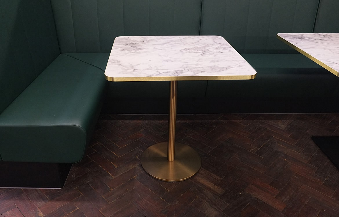 inox brass table with a marble top