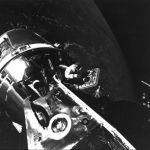 Scott standing in the open hatch of the Command Module