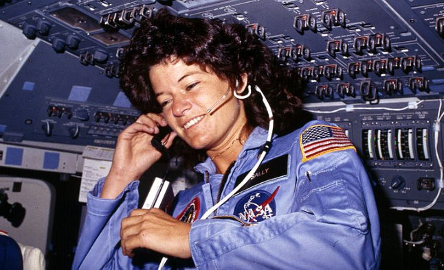 This NASA file photo, dated June 1983, shows America's first woman astronaut Sally Ride as she communicates with ground controllers from the flight deck during the six-day space mission of the Challenger (Credits: NASA/Getty Images).