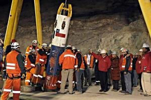Rescue workers prepare to pull up Chilean miners trapped underground for 69 days using a capsule that incorporated suggestions from NASA (Credits: Alex Ibanez/AP).