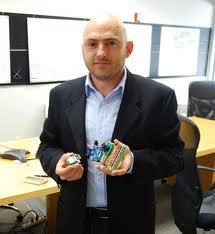 NanoSatisfi's CEO Peter Platzer demos a model of ArduSat (Credits: NanoSatisfi).