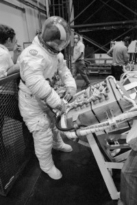 "As the first crew prepared for its own repairs, the astronauts of Skylab's second crew were getting ready for their own mission. Here Jack Lousma practices the installation of a ""six-pack"" of control gyroscopes (Credits: NASA)."