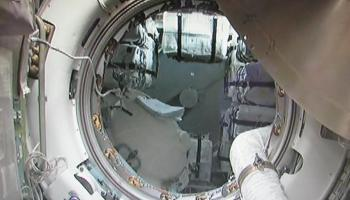 First view from ISS inside ATV-4, shortly after final hatch opening (Credits: ESA/Lionel Ferra).