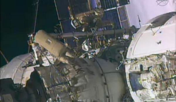 Yurchikhin and Misurkin translating on the Strela boom (Credits: NASA TV)