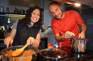 """The social function of the HI-SEAS dinners are an integral element to psychological well-being during the study period. """"As a commander I also learned that it's crucial to keep people talking, and keep the group (physically and emotionally) together,"""" said crew commander Angelo Vermeulen, pictured right of participant Dr. Yajaira Sierra-Sastre. """"The worst that can happen is everyone working in their own little room all day long."""" (Photo by Dr. Sian Proctor)"""