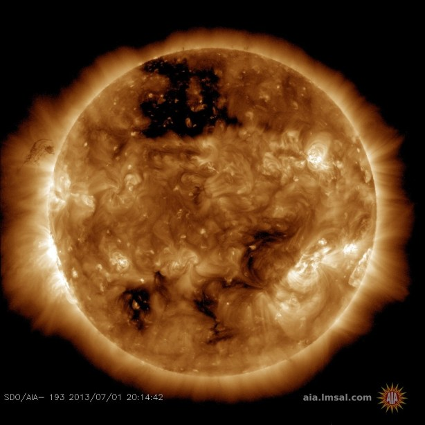 A massive coronal hole can be seen at the top of this solar image from SDO (Credits: NASA/AIA).
