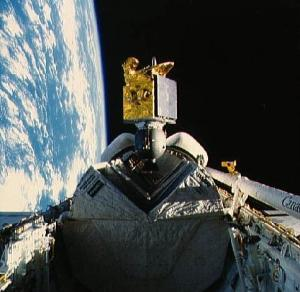 The American Satellite Company's ASC-1 communications satellite spins out of Discovery's payload bay, early in the 51I mission. Note the Pacman-like jaws of the satellite's protective sunshield (Credits: NASA).