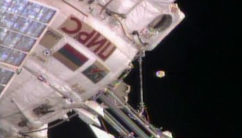 No, that object hovering just off ISS is not alien in origin: it is an antenna cover broken off the Zvezda module (Credits: NASA).