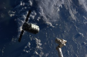 The Cygnus cargo spacecraft is just a few feet away from the International Space Station's Canadarm2 (Credits: NASA).