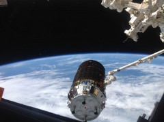 """The HTV-4 """"Kounotori"""" (""""White Stork"""") cargo craft is captured by the station's Canadarm2 on 9 August (Credits: NASA)."""