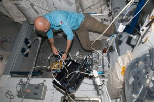 As part of preparations for the arrival of Cygnus, Luca Parmitano works to configure the Common Berthing Mechanism (CBM) Centerline Berthing Camera System (CBCS) inside the space station's Harmony node last week (Credits: NASA).