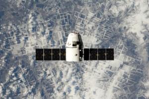 Dragon capsule in orbit (Credits: NASA).