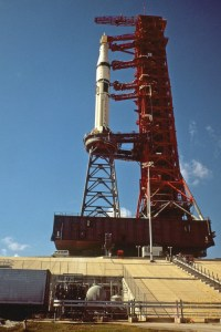 "Pad 39B was originally designed for the large Saturn V, and the smaller Saturn IB for the Skylab missions required a ""milk stool"" to elevate it to the proper level to access the gantry's utilities and umbilicals (Credits: NASA)."