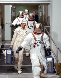 Gerry Carr leads his crew out of the astronaut quarters at the Kennedy Space Center in the hours before launch (Credits: NASA).