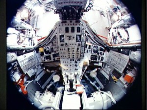 This fish-eye view of the interior of Gemini VII reveals the limited space available to Frank Borman and Jim Lovell during their 14-day mission. Within this cramped volume were not only the men themselves, but their food, experiments, cameras … and bags for their bodily wastes. Both astronauts likened it to living for two weeks in a men's room (Credits: NASA).