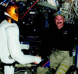 In 2011, Robonaut 2  began its mission assisting with tedious tasks aboard the International Space Station. In 2012 it was party to the first human-robot handshake in space, shared with Commander Dan Burbank (Credits: NASA).