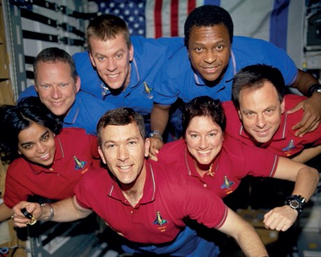 This photograph was taken aboard Columbia during STS-107; it was developed after the crew's death from film recovered in the wreckage. From top left: David M. Brown, William C. McCool, and Michael P. Anderson. From bottom left: Kalpana Chawla, Rick D. Husband, Laurel B. Clark, and Ilan Ramon (Credits: NASA).