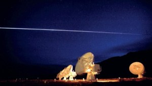 Space Shuttle Columbia streaking over the Very Large Array radio telescope in  Socorro, New Mexico