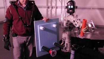 Chris and BERT-2 cooperate to build a table (Credits: Bristol Robotics Laboratory).