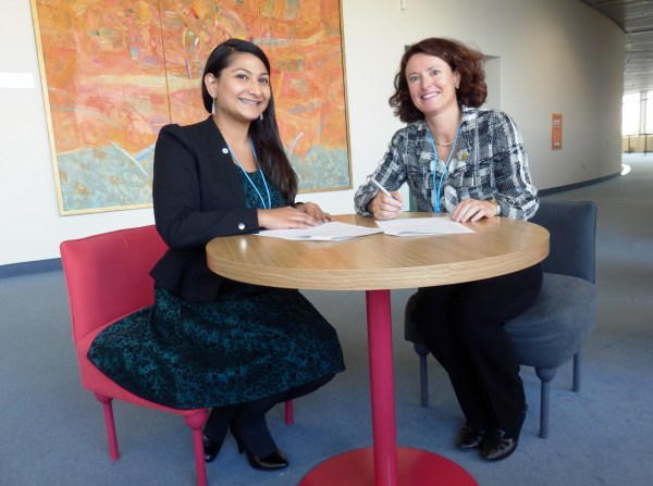 SGAC Executive Director Minoo Rathnasabapathy (left) and IAASS President Isabelle Rongier (right) sign the MoU.