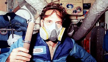 Astronaut Jerry Linenger wears a respirator mask following the 1997 fire aboard Mir. Credits: NASA