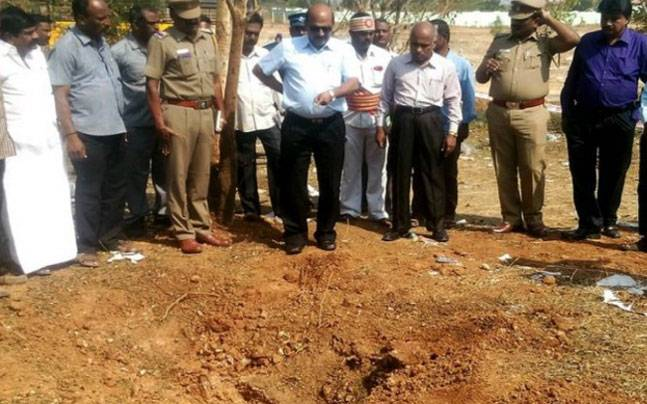 Officials inspect the site of a meteorite strike at a college in Vellore, India. credits: India Today
