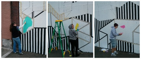 Community volunteers (L to R): Jennifer English, Elysa Saito and Sur Holland fill in color on Surma's mural.