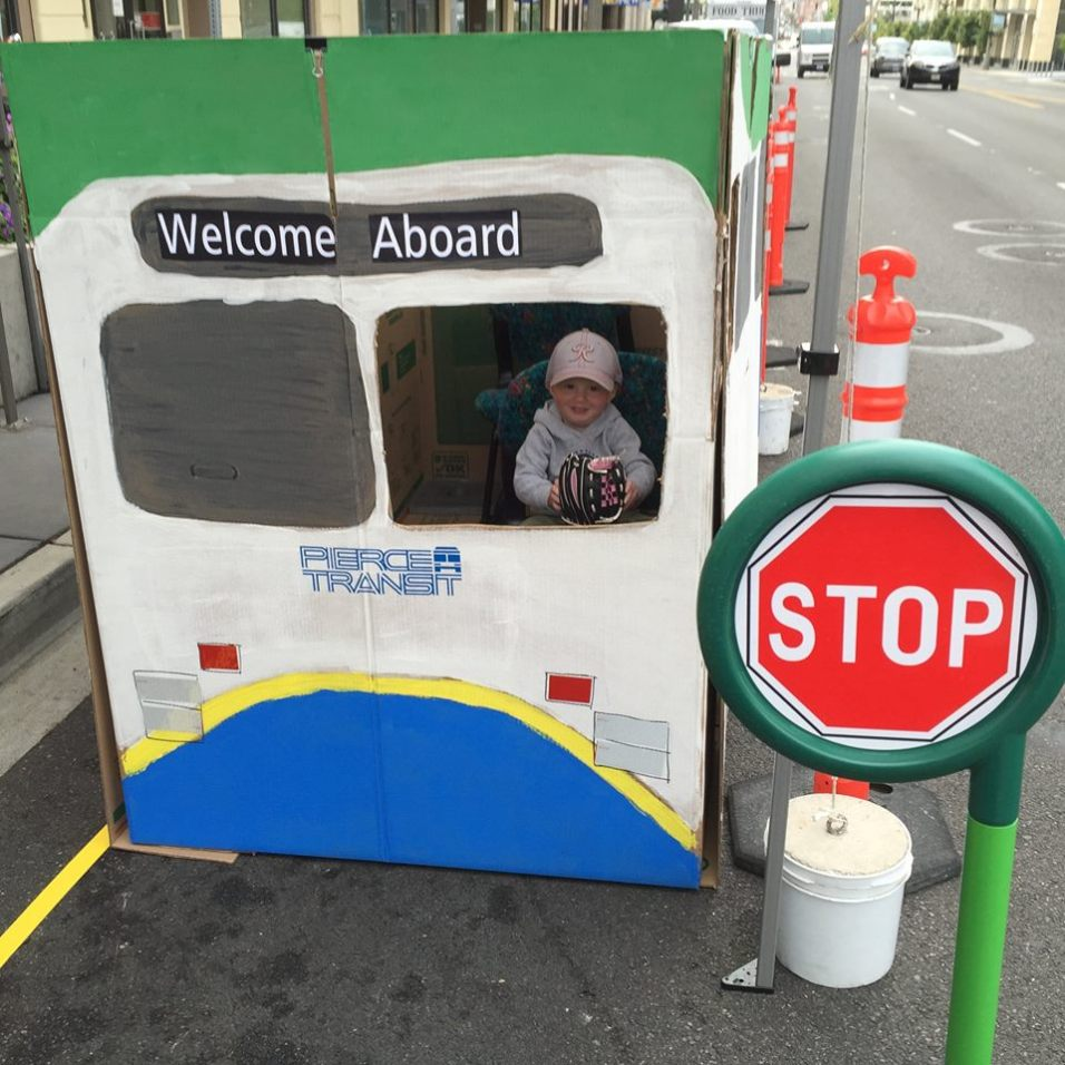 Pierce Transit set up a fun photo booth by building DIY cardboard bus. Park(ing) Day 2015