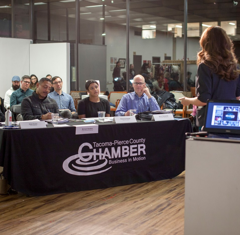 Entrepreneur Rochelle Bergstrom pitches her business plan for Elope 253 to local experts at Fish Tank, fall 2016. This was the first time Spaceworks hosted the event publicly. Photo by Kris Crews.