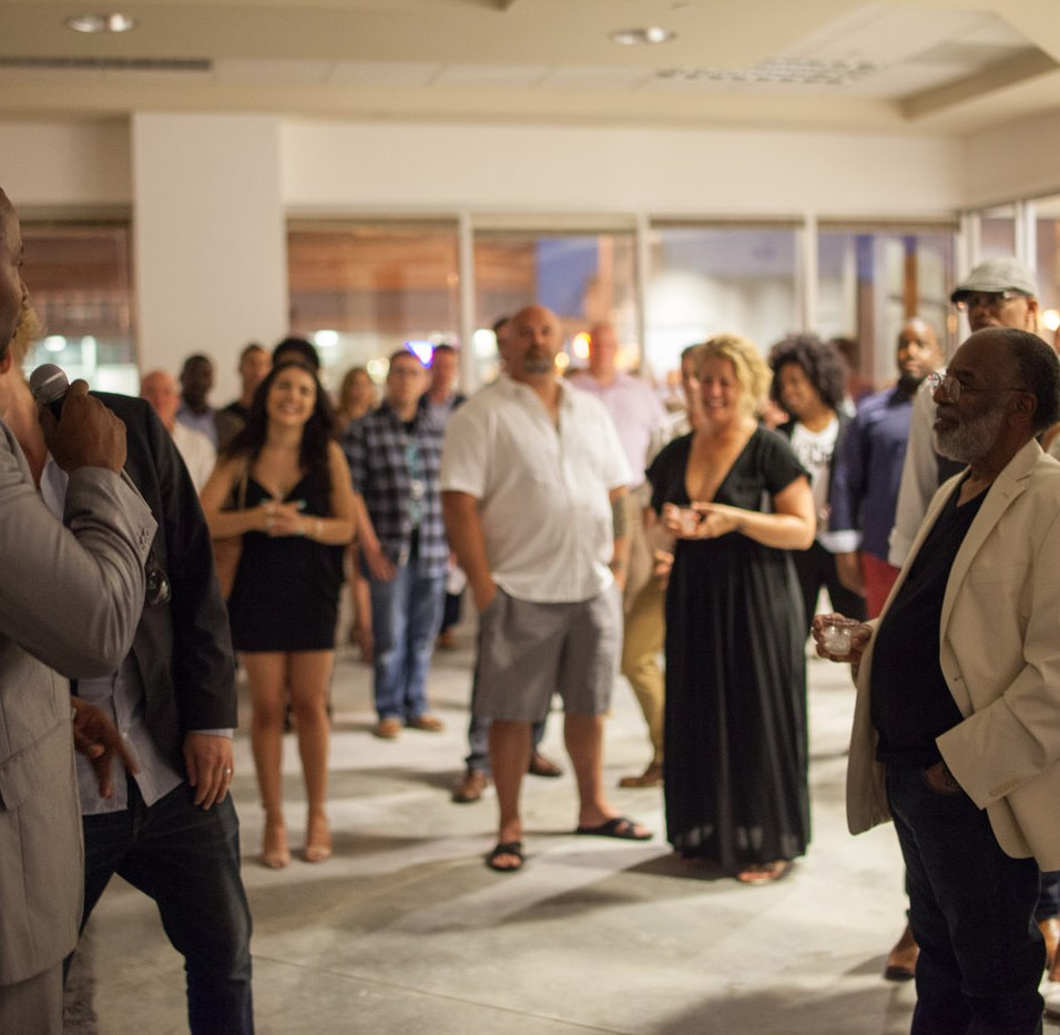 Erik Bernard addresses guests at the Grand Opening party for Have Not Films. HNF partnered with Spaceworks to secure a space on MLK Jr. Way and began re-branding in fall of 2016. Photo by Kris Crews.