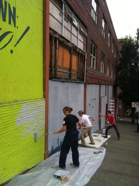 Heather Joy and volunteers prepare a wall for new mural in Tacoma