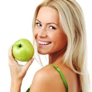 fees at the Plymouth surgery - Denplan lady with apple