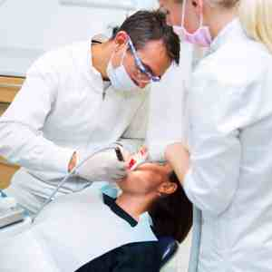 SpaDental Group two dentists doing oral surgery