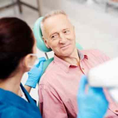 dental implant assessment on an older patient in the surgery