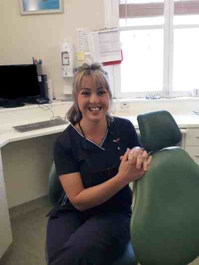 portrait of Lucy Williams new Glastonbury dentist in surgery