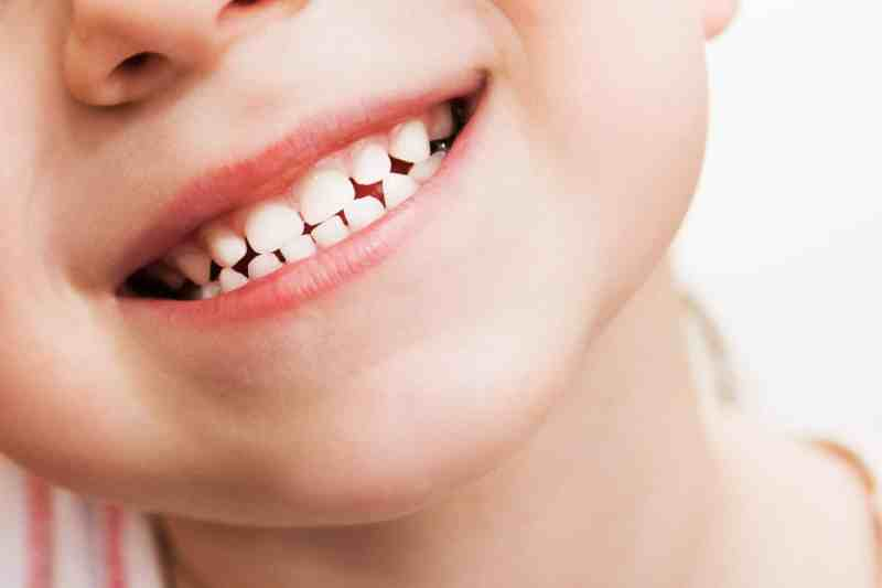 smiling child close up keeping healthy teeth for longer